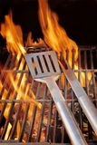 Barbecue Utensils on Hot Grill XXXL Royalty Free Stock Photos