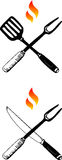 Barbecue Utensils. Two symbols of barbecue exemplified as crossed fork and knife, and fork and spatula, with flames above them Royalty Free Stock Photos