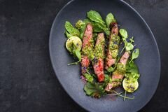 Free Barbecue Wagyu Hanging Tender Steak With Chili, Lettuce And Chimichurri Sauce On A Modern Design Plate Stock Images - 189825794