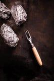 Barbecued картошки обернутые фольгой Стоковые Изображения