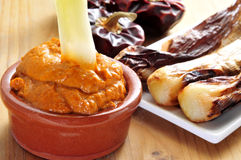Barbecued calcots, sweet onions, and romesco sauce typical of Ca Stock Photo