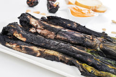 Barbecued calcots, sweet onions, and romesco sauce typical of Ca Royalty Free Stock Images