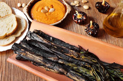Barbecued calcots, sweet onions, and romesco sauce typical of Ca Stock Photos