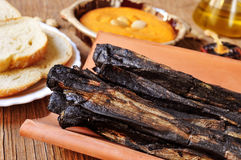 Barbecued calcots, sweet onions, and romesco sauce typical of Ca Royalty Free Stock Photography