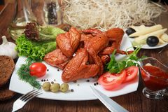 Barbecued chicken drumsticks and vegetables.  stock photography