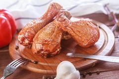 Barbecued chicken drumsticks and vegetables.  royalty free stock photography