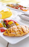 Barbecued chicken with fresh vegetables. Barbecued chicken with fresh vegetable sides shot in tall vertical composition stock photography