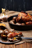 Barbecued chicken leg with baked potatoes Royalty Free Stock Image