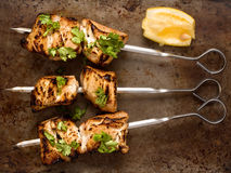 Barbecued chicken skewer Stock Images