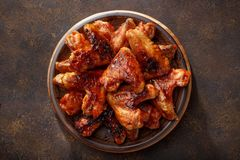 Barbecued chicken wings in the bbq sauce on the plate. Step by step recipe of homemade bbq wings top view royalty free stock photos