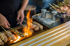 Yakitori in Japanese market food. Traditional yakitori chicken stand in Japan at street food vendor market, grilled satay. Japanese Food Stock Photo