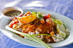 Barbecued and crispy pork in red sauce with rice Stock Photo
