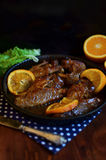 Barbecued duck wings with oranges Royalty Free Stock Photos