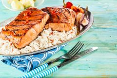 Barbecued or grilled thick fresh salmon steaks stock photos