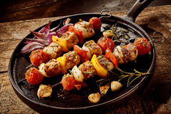 Barbecued kebabs with vegetables and meat Royalty Free Stock Image