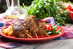 Barbecued kofta with fries on a plate Stock Photography