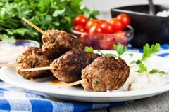 Barbecued kofta with rice on a plate Royalty Free Stock Image