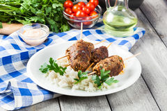 Barbecued kofta with rice on a plate Stock Image