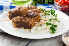 Barbecued kofta with rice on a plate Stock Photo