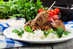 Barbecued kofta with rice on a plate Royalty Free Stock Photo