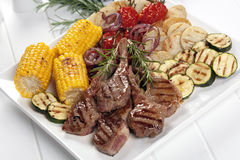 Barbecued Lamb and Grilled Vegetables Royalty Free Stock Photo