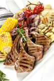Barbecued Lamb and Grilled Vegetables Stock Photo