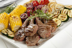 Barbecued Lamb and Grilled Vegetables Stock Photos