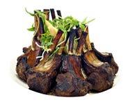 Barbecued lamb racks Stock Images