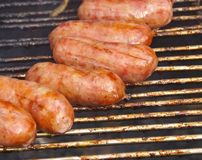 Barbecued meat and pork sausages Stock Images
