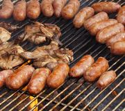 Barbecued meat and pork sausages Royalty Free Stock Image