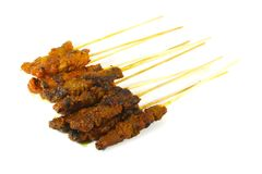 Barbecued Meat Skewered on Bamboo Sticks royalty free stock images