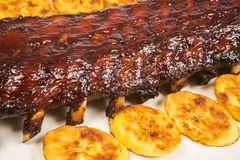 Barbecued Pork Baby Back Rib and Fried Plantains #1 Stock Photography