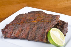 Barbecued Pork Back Ribs. Two pieced of barbecued ribs stock images
