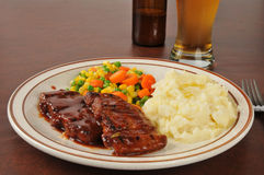 Barbecued pork and beer Royalty Free Stock Photos