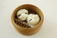 Barbecued pork buns. Yumcha.   dim sum in bamboo steamer with chinese bun , pao , bao zi , steamed dumpling , shumai on table in chinese restaurant. chinese Royalty Free Stock Photo