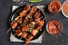 Barbecued pork kebabs Stock Images