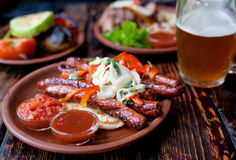 Barbecued pork or lamb meat sausages grill with salad Royalty Free Stock Photos