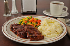 Barbecued pork and mashed potatoes. Boneless barbecued pork with buttered mashed potatoes royalty free stock photos