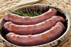 Barbecued pork meat sausages Stock Photos