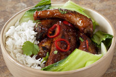 Barbecued Pork Ribs. Barbecued pork spareribs with rice and Asian greens stock image