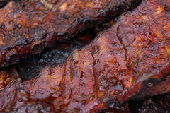 Barbecued pork ribs closeup - spare ribs Royalty Free Stock Image