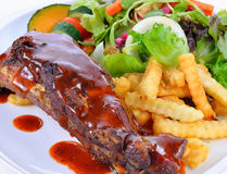 Barbecued pork ribs with French Fries Stock Photos