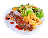 Barbecued pork ribs with Salad and French Fries Royalty Free Stock Image