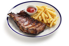 Barbecued pork spare ribs and french fries Royalty Free Stock Image