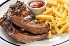 Barbecued pork spare ribs and french fries Stock Images
