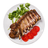 Barbecued pork spare ribs on a white background. Top view stock photography