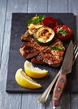Barbecued Pork with Vegetables and Lemon Royalty Free Stock Photos
