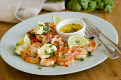 Barbecued prawns. Barbecued tiger prawns with chilli, lime and coriander butter royalty free stock photography