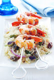 Barbecued Prawns. On a couscous salad, with toasted pistacchios, almonds, pine nuts and raisins royalty free stock photo
