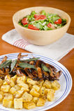 Barbecued Quails with Arugula Salad Stock Image